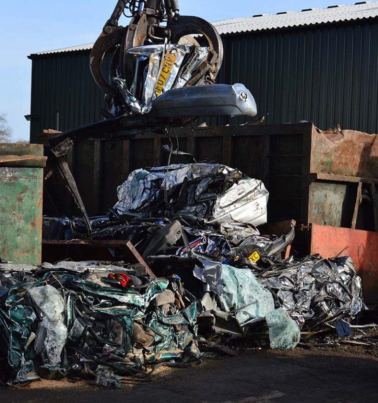 cars being scrapped in a car scrap yard
